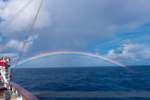 Low Rainbow at the 2013 Eclipse at Sea