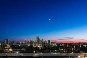 The waxing crescent Moon near Venus in the spring evening sky over the skyline of Calgary, Alberta, May 21, 2015. I shot this from Tom Campbell Hill near the Telus Spark science centre. This is a single exposure with the 16-35mm lens and Canon 60Da, shot as part of a 360-frame time-lapse sequence.