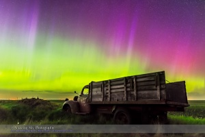 An aurora display on the night of June 7/8, 2015 from southern Alberta, with an old rustic farm truck as the foreground. This is a frame from a 450-frame time-lapse with the Nikon D750 at ISO 1600 and the Sigma 24mm lens at f/2.8, for 8 seconds each. The foreground is from a stack of 8 images adjacent in time to the sky image stacked in Mean mode for smoothing of noise.