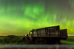 An aurora display on the night of June 7/8, 2015 from southern Alberta, with an old rustic farm truck as the foreground. This is a frame from a 450-frame time-lapse with the Nikon D740 at ISO 1600 and the Sigma 24mm lens at f/2.8, for 8 second each. The foreground is from a stack of 8 images adjacent in time to the sky image stacked in Mean mode for smoothing of noise.