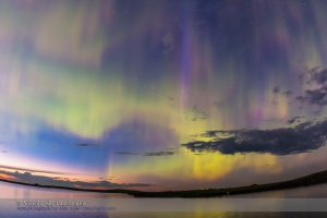 The all-sky aurora of June 22, 2015, during a level 7 to 9 geomagnetic storm, as the display began already active in the twilight of a solstice night. This is one frame from a 960-frame time-lapse, taken with the 15mm full-frame fish-eye lens at f/2.8 and with the Canon 60Da, looking north to the perpetual twilight of solstice. I was on the south shore of Crawling Valley Lake and Reservoir in southern Alberta.