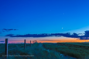 The waxing crescent Moon below Venus and fainter Jupiter above, with the three worlds forming a triangle in the twilight, on the evening of June 19, 2015, from a site north of Bassano, Alberta. This is an HDR stack of 5 exposures to retain detail in the dark foreground and bright twilight sky. This is with the 50mm lens and Canon 6D.
