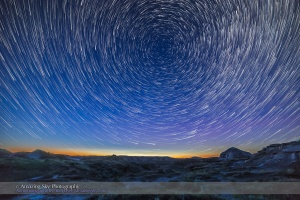 """Summer solstice twilight and circumpolar star trails over the badlands of Dinosaur Provincial Park, Alberta. Some bright noctilucent clouds are visible low on the northern horizon. I shot this June 15, 2015 as part of a shoot for a """"star trail"""" video tutorial, as an example image. This is a stack of the first 200 frames of 275 shot for a time-lapse, each 15 seconds at f/2.8 with the Rokinon 14mm lens and Canon 6D at ISO 1600. I stacked them in Advanced Stacker Actions with the ultrastreak mode. The foreground comes from a mean blend of the first 8 frames, to smooth noise, and to provide a brighter foreground from early in the sequence when the sky and ground were brighter."""
