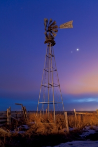 Venus and Jupiter behind old farm water pump windmill, taken March 12, 2012 near home on Glenmore Trail road east of Langdon. Car headlights provide the illumination. Taken with a Canon 5D MkII at ISO 400 and 16-35mm lens at f/4 and 26mm for 20 seconds. A mixture of twilight and light pollution on thin cluds provided the sky colours. Pleiades and Hyades also visible.