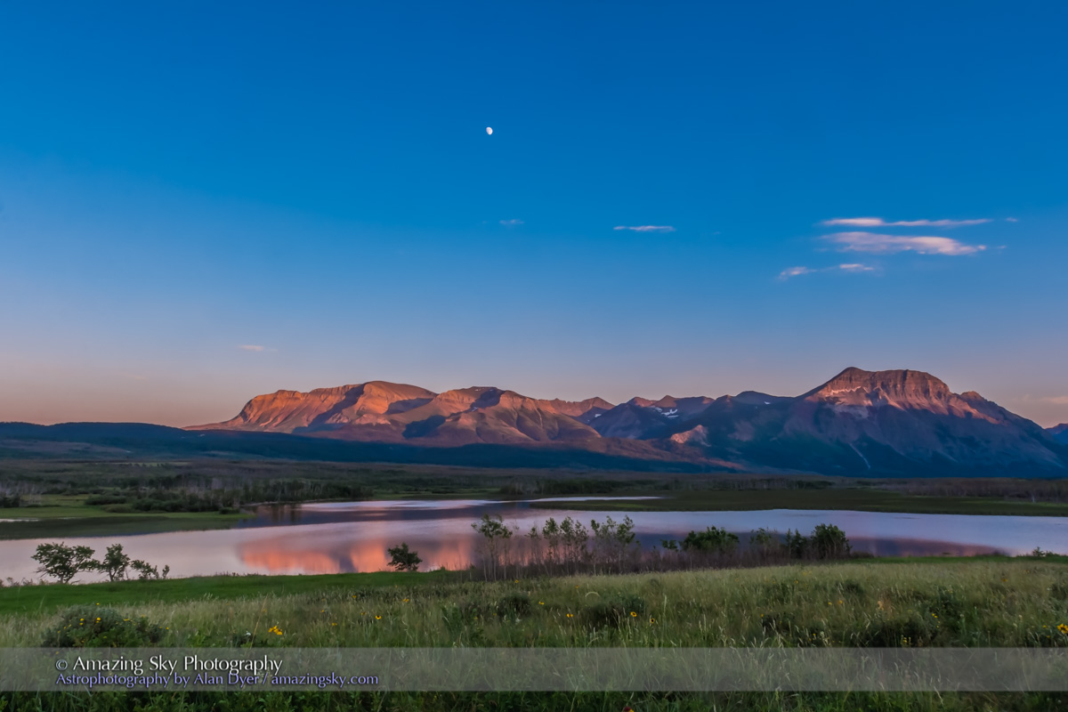 The rising waxing gibbous Moon in the sunset sky over Maskinonge Wetlands at Waterton Lakes National Park, Alberta, June 2015. The last rays of sunset are illuminating the peaks in alpen glow. This is an HDR stack of 3 exposures with the Canon 60Da and 16-35mm lens.