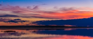 The waxing crescent Moon below Venus low in the sunset colours of a July summer evening over the waters of Little Fish Lake, in southern Alberta. Jupiter is at upper right but much fainter.  This is a 3-segment panorama taken with the Canon 60Da and 18-200mm Sigma zoom.