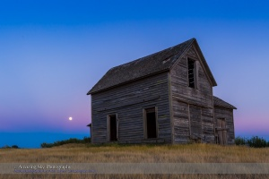 "The rising almost-Full Moon, a ""Blue Moon"" of July 30, 2015, rising behind a rustic old farmhouse near Bow Island, Alberta. The Moon sits in the pibk Belt of Venus with the blue shadow of the Earth below. This is a single frame from a 600-frame time-lapse sequence, taken with the Canon 6D and 16-35mm lens."