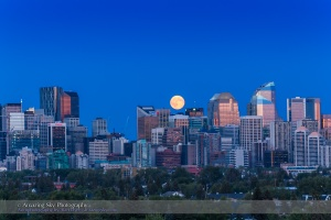 "The Full Moon of July 31, 2015, an infamous ""blue Moon"", the second Full Moon of July, rising over the skyline of Calgary, Alberta. This is one frame of a 480-frame time-lapse sequence taken with the Canon 60Da and 28-105mm lens. The location was Toronto Crescent."