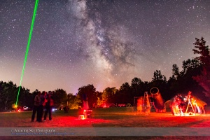 A scene at the Nova East Star Party near Windsor, Nova Scotia, in August 2015, showing laser pointer in use under a clear starry sky.