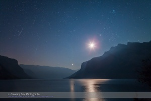 A trio of Perseid meteors shoot at left in the pre-dawn sky over Lake Minnewanka in Banff National Park. The overexposed waning crescent Moon shines between Venus (below) and Jupiter (above), with Jupiter near the Hyades and below the Pleiades in Taurus. Taken the morning of Sunday, August 12, 2012 with the Canon 5D MkII and 24mm Canon L-series lens. This is a composite of three exposures, one for each meteor, each for 40 seconds at ISO 2000 and f/5. Landscape is from one image, two other meteors from two other frames layered in and registered in the correct position in the base layer.