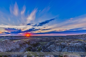 Sunset on August 1, 2015 at the Horsethief Canyon Viewpoint overlooking the Red Deer River, north of Drumheller, Alberta, on the Dinosaur Trail scenic drive. The name comes from the pioneer days when horses would get lost in the Badlands here and then re-emerge found, but with a new brand on them. The region is home to rich deposits of late Cretaceous dinosaur fossils. Just south of here is the world class Royal Tyrrell Museum, a centre of research into dinosaurs and prehistoric life.  This is a single-exposure frame (not HDR) from a 300-frame time-lapse sequence, with the Canon 6D and 16-35mm lens.