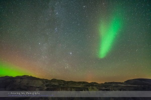 An odd isolated arc of aurora in the eastern sky over the badlands of Dinosaur Provincial Park, Alberta, on September 11, 2015. This arc sat stationary and pulsed up and down in brightness over a few seconds. It was in some frames but not others. The winter stars of Taurus, including the Pleiades cluster, and Auriga are rising in the east.  The sky here is from a single exposure but the ground came from a Mean Combine stack of 8 exposures to smooth noise. Each was 40 seconds at f/2.8 with the 14mm Rokinon lens and Canon 5D MkII at ISO 3200 on a moonless night.