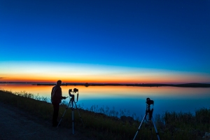 Me with cameras shooting time-lapses at Crawling Lake reservoir, Alberta, June 30/July 1, 2013. Perpetual twilight of summer solstice shines to the north and very weak noctilucent clouds.