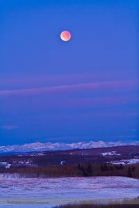 This is the total eclipse of the Moon, December 10, 2011, taken from the grounds of the Rothney Astrophysical Observatory, near Priddis Alberta, and looking west to the Rockies. This is a 2 second exposure at ISO 800 with the Canon 5DMkII and Canon 200mm lens at f/4. This was taken toward the end of totality at 7:48 am local time.