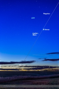 Four planets in the morning sky, on October 20, 2015, along the ecliptic from bottom to top:  - Mercury (close to the horizon at lower left) - Mars (dim, below Jupiter) - Jupiter (fairly bright at upper right) - Venus (brightest of the four) I shot this from home in southern Alberta. This is a composite stack of 5 exposures from 15 seconds to 1 second to contain the range of brightness from the bright horizon to the dimmer sky up higher. All with the 35mm lens and Canon 6D at ISO 800.
