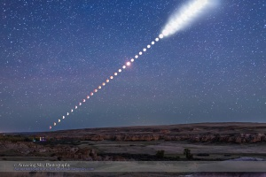 This is a multiple-exposure composite of the total lunar eclipse of Sunday, September 27, 2015, as shot from Writing-on-Stone Provincial Park, Alberta, Canada. From this location the Moon rose in the east at lower left already in partial eclipse. As it rose it moved into Earth's shadow and became more red and the sky darkened from twilight to night, bringing out the stars. Then, as the Moon continued to rise higher it emerged from the shadow, at upper right, and returned to being a brilliant Moon again, here overexposed and now illuminating the landscape with moonlight. The disks of the Moon become overexposed here as the sky darkened because I was setting exposures to show the sky and landscape well, not just the Moon itself. That's because I shot the frames used to assemble this multiple-exposure still image primarily for use as a time-lapse movie where I wanted the entire scene well exposed in each frame. Indeed, for this still image composite of the eclipse from beginning to end, I selected just 40 frames taken at 5-minute intervals, out of 530 I shot in total, taken at 15- to 30-second intervals for the full time-lapse sequence. All were taken with a fixed camera, a Canon 6D, with a 35mm lens, to nicely frame the entire path of the Moon, from moonrise at left, until it left the frame at top right, as the partial eclipse was ending. The ground comes from a blend of 3 frames taken at the beginning, middle and end of the sequence, so is partly lit by twilight, moonlight and starlight. Lights at lower left are from the Park's campground. The sky comes from a blend of 2 exposures: one from the middle of the eclipse when the sky was darkest and one from the end of the eclipse when the sky was now deep blue. The stars come from the mid-eclipse frame, a 30-second exposure. PLEASE NOTE: The size of the Moon and its path across the sky are accurate here, because all the images for this composite were taken with the same lens using a camera that did not m
