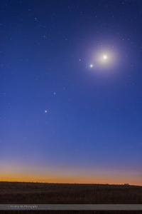 A gathering of planets in the dawn sky on October 8, 2015, with - from bottom to top: Jupiter, Mars, Venus and the Moon, with the star Regulus in Leo left of Venus.  This is a 15-second exposure with shorter exposure blended in for the area around Venus and the Moon to avoid them overexposing too much. So not a true HDR, but using masking to blend the short exposure elements.