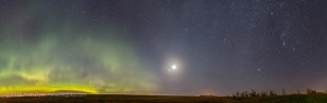 A panorama of the pre-dawn sky on October 8, 2015, with a sky full of wonders: • the Northern Lights, or aurora • The Big Dipper above the aurora, somewhat distorted by the panorama projection • at centre, a conjunction and line-up of planets, with from bottom to top: Jupiter, Mars and Venus, with the bright waning crescent Moon beside Venus at top, and also beside the star Regulus in Leo • The Beehive star cluster well above the planet grouping • Orion and Canis Major in the winter sky at right with the Milky Way. I shot this from home, using the Canon 6D and 24mm lens on a fixed tripoid (no tracking), for 7 segments, each a 30-second exposure at f/2.2 and at ISO 1250. Stitched in Photoshop.