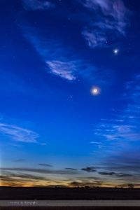 The waning crescent Moon, lit by Earthshine, with four planets on the morning of October 9, 2015, with the planets from bottom left to top right: • Mercury, just above the horizon between the low cloud bands, at lower left • Jupiter, bright at centre • Mars, reddish and above Jupiter • Venus, brightest at upper right and in some thin cloud.  The bright star Regulus in Leo is above and to the left of Venus. This is a blend of four exposures: a long 4-second exposure for most of the sky and ground and shorter 2, 1, amd 1/2 second exposures for the bright twilight area and around the Moon and Venus, to prevent those areas fro being blown out. Blending is with masks, not HDR. All with the Canon 6D at ISO 400 and 50mm Sigma lens at f/2.5