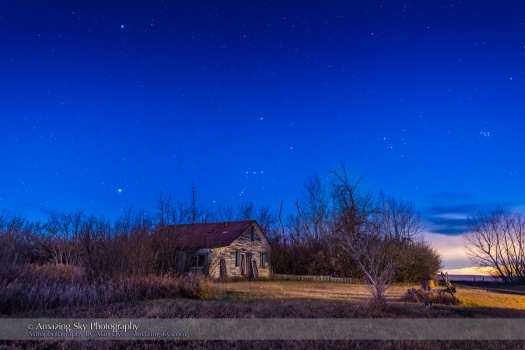 Orion and the winter constellations setting over the old Farmhouse at home, in the dawn twilight on the morning of November 14, 2015. Canis Major and Sirius are at left; Taurus and Aldebaran and the Pleiades are at right. Procyon is at upper left.  This is a stack of 4 x 20 second exposoures for the ground to smooth noise and one 20-second exposure for the sky, all with the Nikon D810a at ISO 1600 and 14-24mm Nikkor zoom lens at f/2.8.