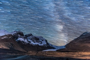 Stars setting in trails over the Athabasca Glacier and Columbia Icefields, Sept 14, 2014. The Milky Way is trailed at right. This is a stack of 100 exposures, composited with Advanced Stacker Plus actions in Photoshop, with the ground coming from a subset stack of 8 images to reduce noise. Each exposure, taken as part of a time-lapse sequence, was 45 seconds at f/2.8 with the 16-35mm lens at 23mm and Canon 6D at ISO 4000.