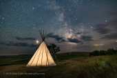 Mars (at left) and the Milky Way (at right) over a single tipi (with another under construction at back) at the Two Trees site at Grasslands National Park, Saskatchewan, August 6, 2018. I placed a low-level warm LED light inside the tipi for the illumination. This is a stack of 6 exposures, mean combined to smooth noise, for the ground, and one untracked exposure for the sky, all 30 seconds at f/2.2 with the 20mm Sigma lens and Nikon D750 at ISO 3200.
