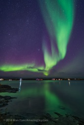 A curtain of aurora sweeps over the houseboats moored on Yellowknife Bay in Yellowknife, NWT, on September 11, 2018. The Pleiades and Hyades star clusters in Taurus are rising at left. This is a mean-combined stack of 8 images to smooth noise for the ground and water, and a single exposure for the sky and houseboats themselves (as they were moving slightly from exposure to exposure). Each was 13 seconds at f/2 with the Venus Optics 15mm lens and Sony a7III at ISO 3200.