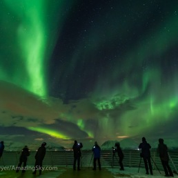 Aurora photographers and observers on the rear deck 9 area of the Hurtigruten ferry ship the ms Trollfjord on the southbound voyage along the Norwegian coast, on March 2, 2019. This is a single 1.6-second exposure at f/2 with the 15mm Venus Optics lens and Sony a7III at ISO 6400.