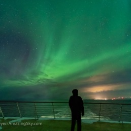 A self-portrait on the back deck of the ms Trollfjord, southbound out of Berlevag this night and under the Northern Lights.