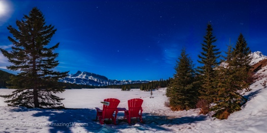 Parks Canada Red Chairs under the Winter Sky at Two Jack Lake